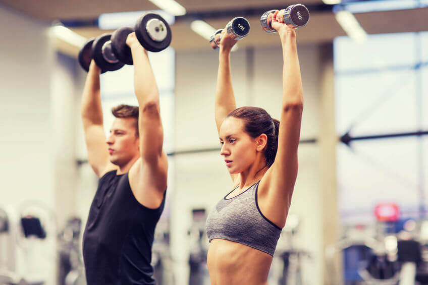 A young, fit couple exercising.